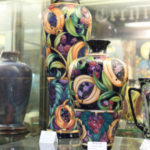 Moorcroft – 'Garnet Apple' Vase (foreground)