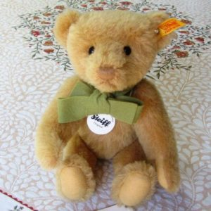 Classic Teddy with green felt bow