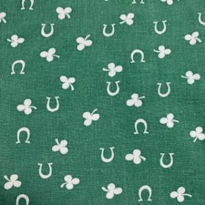Feed Sack Vintage Fabric – green background, white shamrocks & horseshoes
